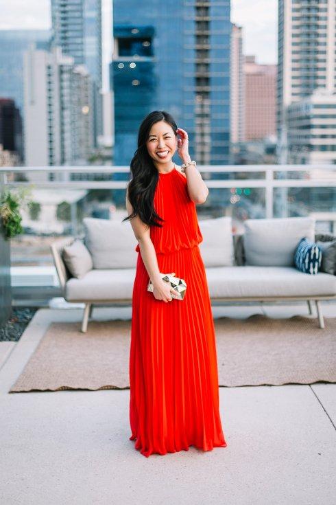 janna-doan-pleated-red-maxi-dress-gold-clutch